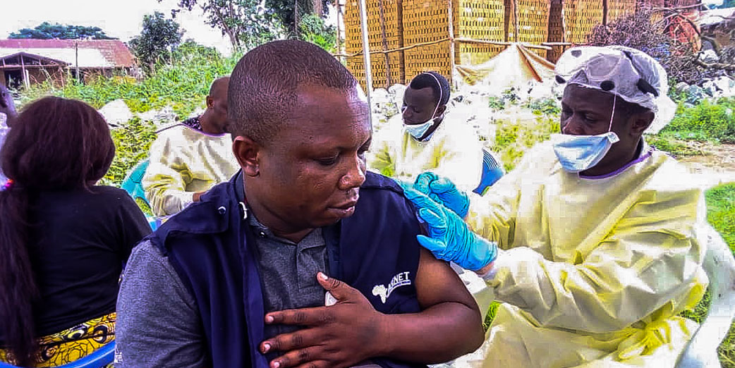 Dr Samuel OSINGA, ACoDD member being vaccinated during the Ebola Response in DRC