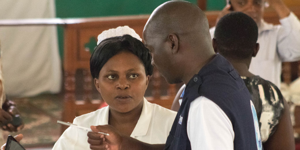 Dr. Ben Masiira, Epidemiologist interviewing a nurse during a health workers sensitization activity during the Ebola outbreak in Kasese