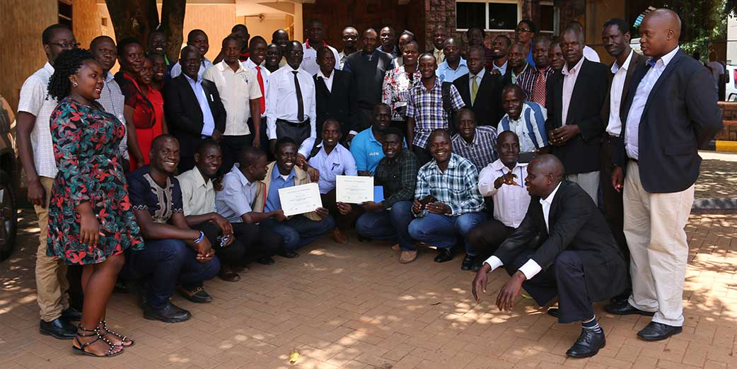 Participants at the Frontline Cohort VIII graduation, Gulu Uganda pose for a group photo with their mentors