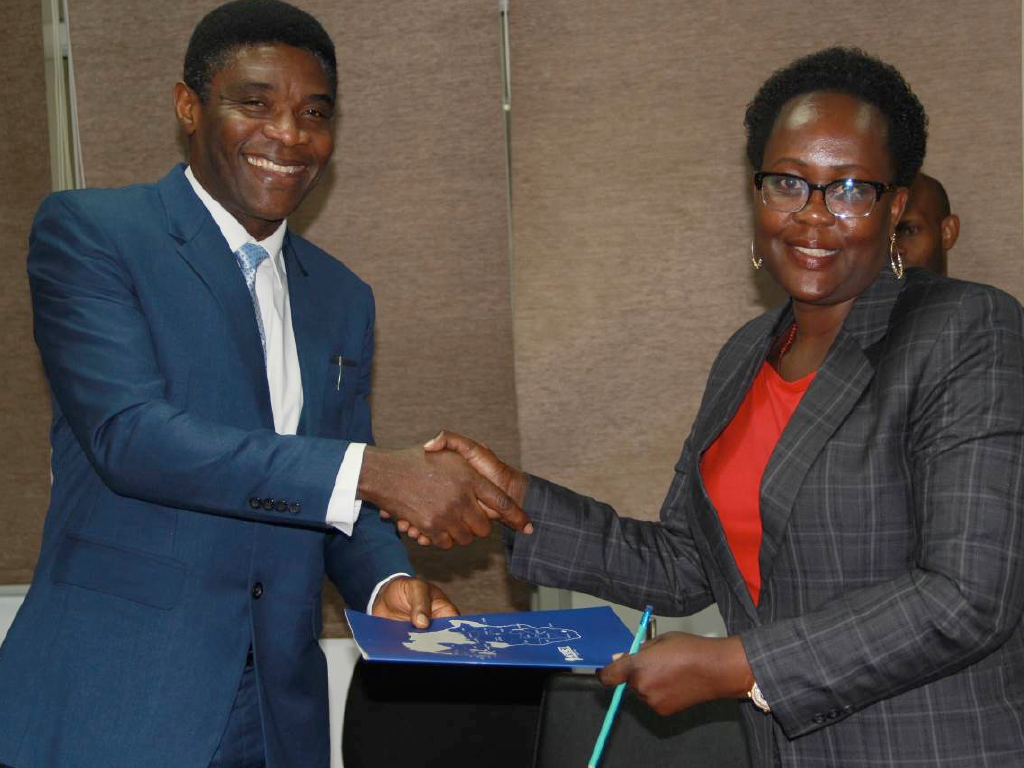Dr Olivia Namusisi – Former Acting Executive Director hands over office to new Executive Director Dr. Chima John Ohuabunwo (Photo courtesy of Racheal Chelimo)